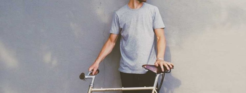 A guy pauses to relax after riding his bike